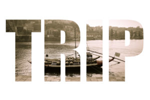 Word TRIP over boat with barrels of wine at the berth. Douro River. city of Porto. Toned